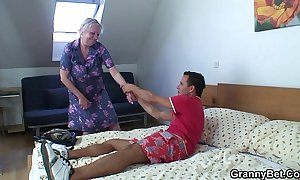 Light-complexioned aged granny is doggy position fucked