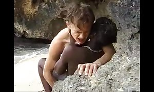 African teen acquires anal fucked on an obstacle seaside